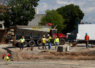 Gravel is being tossed into a trench as work continues on the sewer line upgrade project on Waverly Avenue. Photo taken July 18, 2017